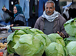 A man selling cabbages in the market of the Nuseirat refugee camp in the middle of the Gaza strip.  While Gazans grow much of their own food, repressive restrictions on land use imposed by the Israeli military means some food has to be imported at great cost from Egypt and Israel....