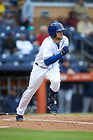 Christian Arroyo (24) of the Durham Bulls hustles down the first base line against the Gwinnett Braves at Durham Bulls Athletic Park on April 20, 2019 in Durham, North Carolina. The Bulls defeated the Braves 11-3 in game one of a double-header. (Brian Westerholt/Four Seam Images)
