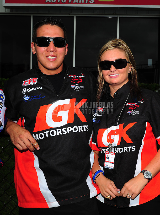 Apr. 29, 2012; Baytown, TX, USA: NHRA pro stock drivers Erica Enders (right) with teammate Dave Connelly during the Spring Nationals at Royal Purple Raceway. Mandatory Credit: Mark J. Rebilas-