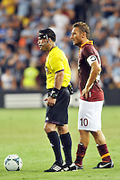 Sporting Park, Kansas City, Kansas, July 31 2013:<br /> Referee Hilario Grajeda wearing camera on head band stands next to AS Roma captain Francesco Totti.<br /> MLS All-Stars were defeated 3-1 by AS Roma at Sporting Park, Kansas City, KS in the 2013 AT & T All-Star game.