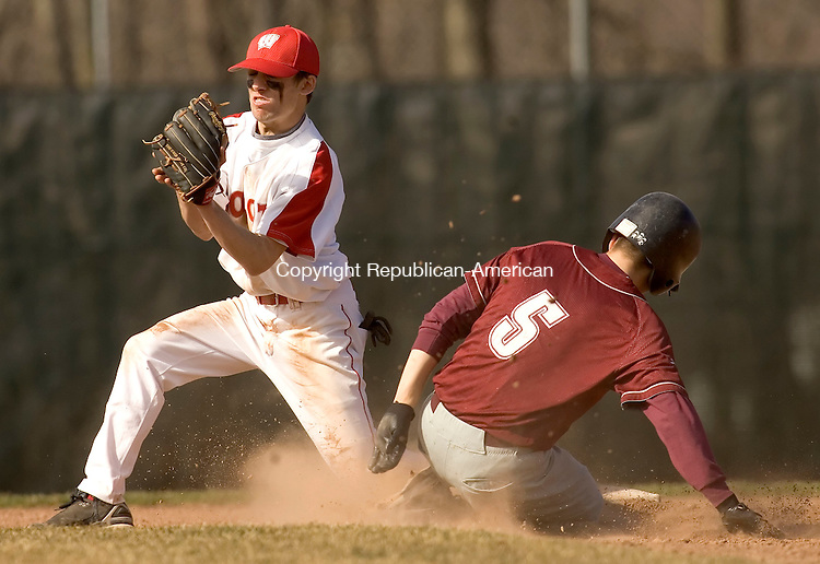 WOLCOTT, CT- 19 APRIL 2007-041907JS07-Naugatuck's Mike Edwards is called safe at second while Wolcott's Tom Jannetty covers the play during their game Thursday at Wolcott High School.-- --Jim Shannon / Republican-American