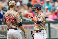 Virginia Cavaliers pinch runner Thomas Woodruff (37) is greeted by pitcher Connor Jones (33) after scoring against the Arkansas Razorbacks in Game 1 of the NCAA College World Series on June 13, 2015 at TD Ameritrade Park in Omaha, Nebraska. Virginia defeated Arkansas 5-3. (Andrew Woolley/Four Seam Images)