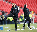 Neil Lennon boots a water bottle as Derek McInnes celebrates