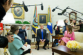 US President Donald J. Trump (2-R) meets with the President of Colombia Ivan Duque (2-L), beside US First Lady Melania Trump (R) and First Lady of Colombia Maria Juliana Ruiz Sandoval (L), in the Oval Office of the White House in Washington, DC, USA, 13 February 2019. President Trump and President Duque are meeting to discuss economic policies, combatting narcotics and the current situation in Venezuela.<br /> Credit: Michael Reynolds / Pool via CNP