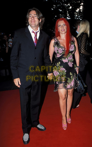 JONATHAN ROSS, JANE GOLDMAN.Terminator 3: Rise of The Machines Film Premiere at Odeon Leicester Square.www.capitalpictures.com.sales@capitalpictures.com.© Capital Pictures.two-tone shoes, two tone, checked..full length, full-length
