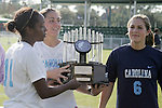 11 November 2007: North Carolina captains Robyn Gayle (11), Jessica Maxwell (center), and Katie Brooks (6) lift the Atlantic Coast Conference Women's Soccer Chapmionship trophy. The University of North Carolina defeated Florida State University 1-0 at the Disney Wide World of Sports complex in Orlando, FL in the Atlantic Coast Conference Women's Soccer tournament final.