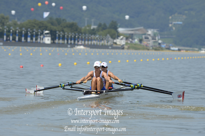 Chungju, South Korea. GBR LW2X, Bow Kathryn TWYMAN and Imogen WALSH, at the start of their heat at the 2013 FISA World Rowing Championships,  Tangeum Lake International Regatta Course. 12:34:10  Sunday  25/08/2013 [Mandatory Credit. Peter Spurrier/Intersport Images]