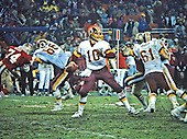 Washington Redskins quarterback Jay Schroeder (10) looks to pass in the game against the San Francisco Forty-Niners at RFK Stadium in Washington, D.C. on Sunday, December 1, 1985.  Blocking for Schroeder are left tackle Joe Jacoby (66) and right guard Ken Huff (61).  The Forty-Niners won the game 35 - 8.<br /> Credit: Arnie Sachs / CNP