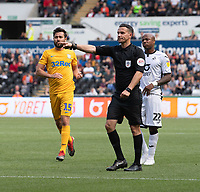 Referee Dean Whitestone awards Preston North End with a penalty for Swansea City's Connor Roberts foul on Preston North End's Sean Maguire <br /> <br /> Swansea City's Connor Roberts (left) tackle on  Preston North End's Sean Maguire (right) results in a penalty to c<br /> <br /> Photographer David Horton/CameraSport<br /> <br /> The EFL Sky Bet Championship - Swansea City v Preston North End - Saturday 17th August 2019 - Liberty Stadium - Swansea<br /> <br /> World Copyright © 2019 CameraSport. All rights reserved. 43 Linden Ave. Countesthorpe. Leicester. England. LE8 5PG - Tel: +44 (0) 116 277 4147 - admin@camerasport.com - www.camerasport.com