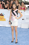 LOS ANGELES, CA - APRIL 12: Actress Victoria Justice arrives at the 2015 MTV Movie Awards at Nokia Theatre L.A. Live on April 12, 2015 in Los Angeles, California.
