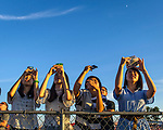 A near record crowd hot air balloon fans filled the hillsides at the National Balloon Classic launch field July 29 for opening ceremonies, balloon launches and music. A foursome of high school students from Japan point their cell phones skyward to capture images of the official launch. The are among a group of exchange students attending a Lincoln High program through Central Academy. They are hosted by Iowa Sister Schools.