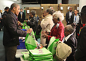United States President Barack Obama fills bags with produce at the Capital Area Food Bank in North East Washington DC on Wednesday, November 23, 2011. .Credit: Dennis Brack / Pool via CNP