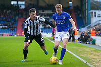 Oldham Athletic's Eoin Doyle under pressure from Rochdale's Harrison McGahey during the Sky Bet League 1 match between Oldham Athletic and Rochdale at Boundary Park, Oldham, England on 18 November 2017. Photo by Juel Miah/PRiME Media Images