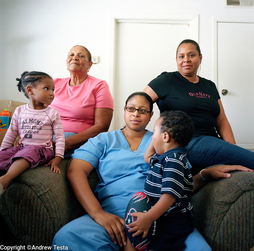 USA. Houston. 12 November 2007..Jovelle Joubert, Linda Carty's daughter (middle), photographed with Linda's mother Enid Carty (left), and Linda's sister (name to follow, right). Photographed in Enid Carty's  apartment in Houston..©Andrew Testa
