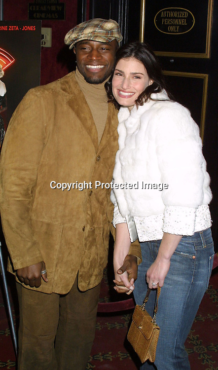 "©2002  AURA BLANDINO/ HUTCHINS PHOTO."" CHICAGO""  SPECIAL SCREENING BENIFITING GLAAD.THE ZIEGFELD THEATRE .NEW YORK, NEW YORK.12/18/02..TAYE DIGGS AND GUEST"
