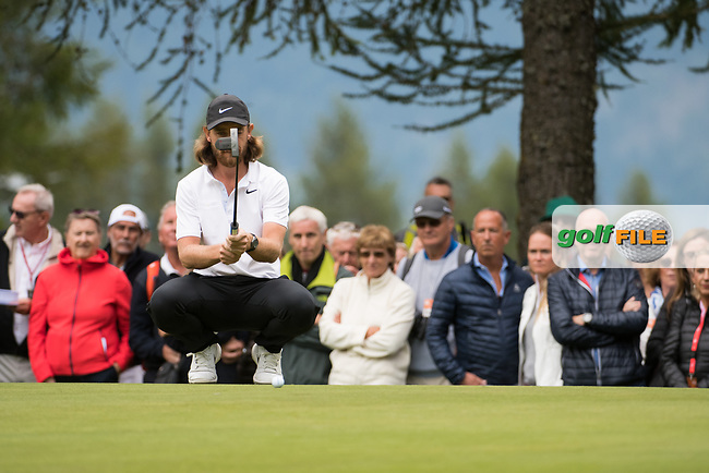 Tommy Fleetwood (ENG) lines up his putt on the 1st hole during final round at the Omega European Masters, Golf Club Crans-sur-Sierre, Crans-Montana, Valais, Switzerland. 01/09/19.<br /> Picture Stefano DiMaria / Golffile.ie<br /> <br /> All photo usage must carry mandatory copyright credit (© Golffile   Stefano DiMaria)