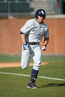 Esteban Puerta (9) of the Florida Atlantic Owls hustles down the first base line against the Charlotte 49ers at Hayes Stadium on March 14, 2015 in Charlotte, North Carolina.  The Owls defeated the 49ers 8-3 in game one of a double header.  (Brian Westerholt/Four Seam Images)