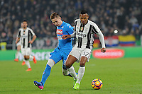 Calcio, semifinale di andata di Tim Cup: Juventus vs Napoli. Torino, Juventus Stadium, 28 febbraio 2017.<br /> Juventus&rsquo; Alex Sandro, right, is challenged by Napoli's Marko Rog during the Italian Cup semifinal first leg football match between Juventus and Napoli at Turin's Juventus stadium, 28 February 2017.<br /> UPDATE IMAGES PRESS/Manuela Viganti