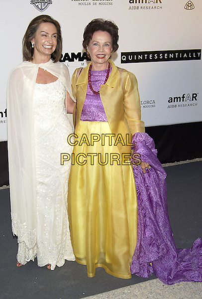 BARBARA GRANT & LESLIE CARON.arrivals at  amfAR 's Cinema Against Aids 2004.at Le Moulin de Mougins .Cannes Film Festival, France 20 May 2004..full length white dress gold yellow jacket skirt purple top wrap shawl.sales@capitalpictures.com.www.capitalpictures.com.©Capital Pictures