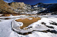 Ice and snow collect at the sandy base of The Sawtooth, near Mt. Bierstadt in Colorado's Rocky Mountains.