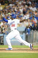 September 24, 2014 Los Angeles, CA:  Los Angeles Dodgers right fielder Yasiel Puig #66 during an MLB game between the San Francisco Giants and the Los Angeles Dodgers played at Dodger Stadium The Dodgers defeated the Giants 9-1 to win the National League West Title.