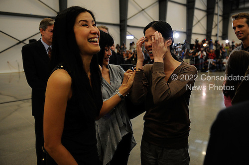 Burbank, CA - August 5, 2009 -- (L-R) Journalist Lisa Ling smiles as she talks with sister/journalist Laura Ling who along with Euna Lee arrived at Hangar 25 on August 5, 2009 in Burbank, California after being released by North Korean authorities yesterday. Ling and Lee, of San Francisco based Current TV, were both arrested by North Korea in March for illegally entering the country on the Chinese border. Yesterday they were pardoned by President Kim Jong-Il after a meeting with former U.S. President Bill Clinton. Ling and Lee had been sentenced to 12 years in prison in June. .Credit: Kevork Djansezian - Getty Images for Shangri-La from CNP
