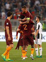 Calcio, Serie A: Roma vs Juventus. Roma, stadio Olimpico, 14 maggio 2017. <br /> Roma&rsquo;s Daniele De Rossi, top, hugs his teammate Antonio Ruediger as Juventus&rsquo; Miralem Pjanic, right, reacts at the end of the Italian Serie A football match between Roma and Juventus at Rome's Olympic stadium, 14 May 2017. Roma won 3-1.<br /> UPDATE IMAGES PRESS/Riccardo De Luca