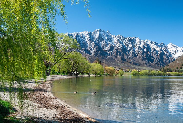 The Remarkables mountain range seen from the shores of Lake Wakatipu at Frankton, Queenstown, New Zealand