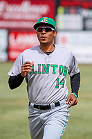 Clinton LumberKings outfielder Dimas Ojeda (14) warms up in the outfield prior to a Midwest League game against the Wisconsin Timber Rattlers on April 26, 2018 at Fox Cities Stadium in Appleton, Wisconsin. Clinton defeated Wisconsin 7-3. (Brad Krause/Four Seam Images)