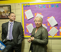 NYC Dept. of Education Chancellor Carmen Fariña ,center, with Principal Dr. Ramon Gonzalez during her visit to MS 223, The Laboratory School of Finance and Technology, in the Bronx borough of New York on Thursday, January 2, 2014, her first day of work.New York Mayor Bill De Blasio appointed career educator Fariña as the head of the New York City public school system.  (© Richard B. Levine)