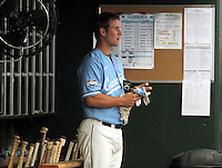 North Carolina's Brian Holberton keeps an eye on the action as he gets ready to bat. Vanderbilt's 5-1 win eliminated North Carolina from the College World Series in Omaha, Neb. (Photo by Michelle Bishop)..