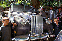 Commander Idi Abdul Tarak with the taxman Abdul Qayum, in autumn 2001 next the English black Austin A135 Princess Vanden Plas Limousine in the Panshir Valley.