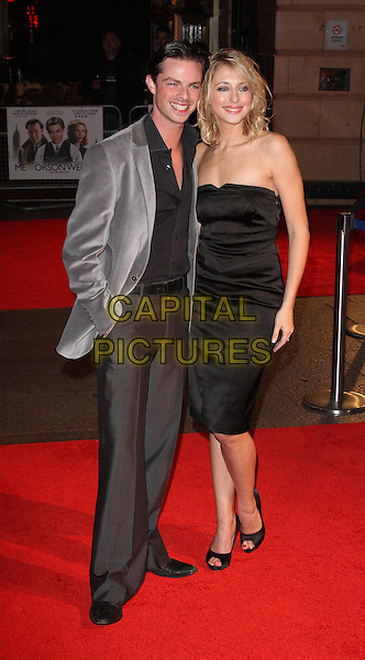 BRIAN FORTUNA & ALI BASTIAN .Attending the UK Premiere of 'Me and Orson Welles' at the Vue West End, Leicester Square, London, UK,.November 18th 2009.full length strapless black dress grey gray jacket trousers hand in pocket peep toe shoes shirt .CAP/ROS.©Steve Ross/Capital Pictures.