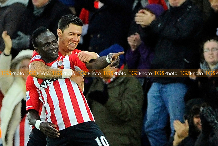 Goalsacorer Sadio Mane of Southampton celebrates with Jose Fonte of Southampton - Southampton vs Arsenal - Barclays Premier League Football at St Mary's Stadium, Southampton, Hampshire - 01/01/15 - MANDATORY CREDIT: Denis Murphy/TGSPHOTO - Self billing applies where appropriate - contact@tgsphoto.co.uk - NO UNPAID USE