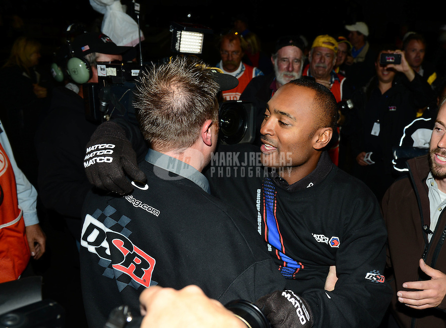Nov. 11, 2012; Pomona, CA, USA: NHRA top fuel dragster driver Antron Brown celebrates after winning the 2012 championship during the Auto Club Finals at at Auto Club Raceway at Pomona. Mandatory Credit: Mark J. Rebilas-