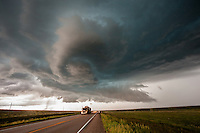 Rotating thunderstorm above semi truck on a Montana highway