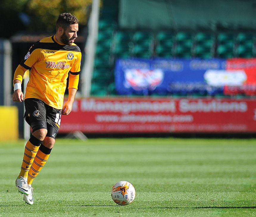Newport County's Robbie Willmott in action during todays match  <br /> <br /> Photographer Kevin Barnes/CameraSport<br /> <br /> Football - The Football League Sky Bet League Two - Newport County AFC v York City - Saturday 11th October 2014 - Rodney Parade - Newport<br /> <br /> &copy; CameraSport - 43 Linden Ave. Countesthorpe. Leicester. England. LE8 5PG - Tel: +44 (0) 116 277 4147 - admin@camerasport.com - www.camerasport.com