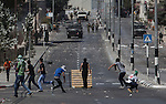Palestinian young facing to israeli army in Bethlehem, West Bank. The palestinians claim the end of the israeli occupation in West Bank.