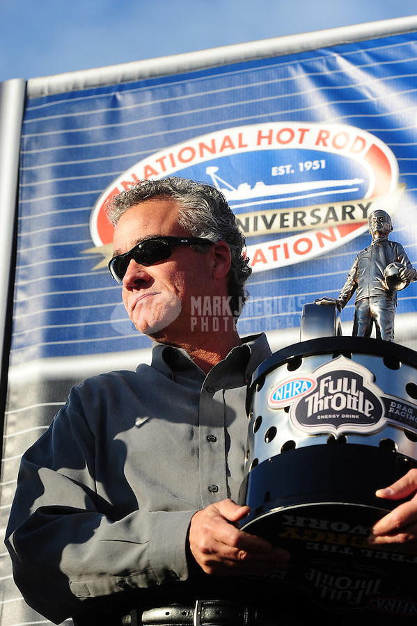 Nov. 13, 2011; Pomona, CA, USA; NHRA president Tom Compton with the championship trophy at the Auto Club Finals at Auto Club Raceway at Pomona. Mandatory Credit: Mark J. Rebilas-.