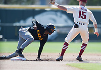 NWA Democrat-Gazette/CHARLIE KAIJO Arkansas Razorbacks infielder Casey Martin (15) tags out University of Missouri outfielder Josh Holt Jr. (1) during a baseball game, Sunday, March 17, 2019 at Baum-Walker Stadium in Fayetteville.