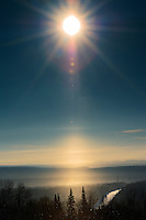 Sun pillar over Lake Superior at sunrise<br /> Marathon<br /> Ontario<br /> Canada