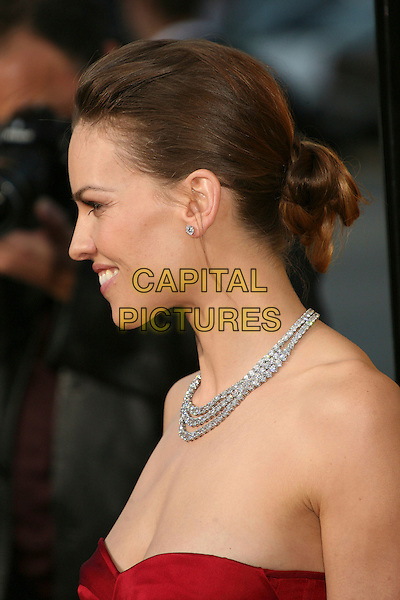 """HILARY SWANK.""""The Reaping"""" Los Angeles Premiere at Mann's Village Theatre, Hollywood, California, USA, 29 March 2007..portrait headshot profile necklace strapless red dress.CAP/ADM/BP.©Byron Purvis/AdMedia/Capital Pictures."""