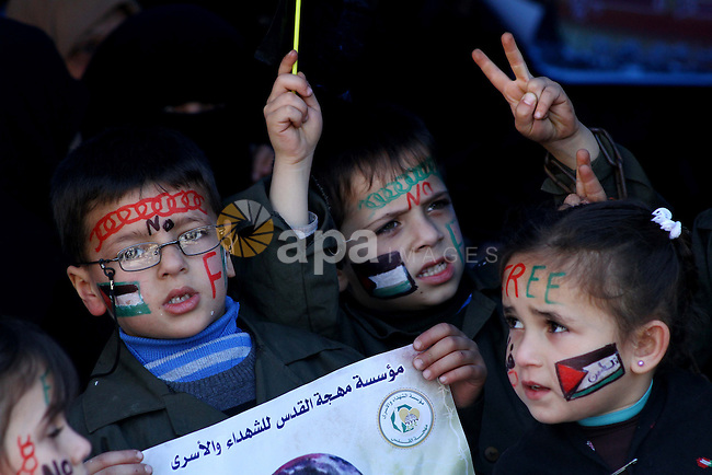 Palestinian children demonstrate in solidarity with Hana'a Shalabi during a protest in front of red cross in Gaza City, on mar. 07, 2012. Shalabi, released by Israel in a prisoner swap last year but re-arrested earlier this month and held without charge, is on a hunger strike to protest her treatment, officials said. The Arabic writing on the sign reads ''Down with administrative detentions'.  Photo by Ashraf Amra