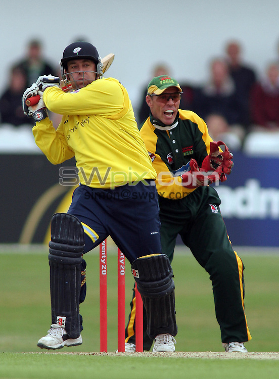 PICTURE BY VAUGHN RIDLEY/SWPIX.COM -  Cricket - Twenty20 Cup - Yorkshire v Leicestershire - Headingley, Leeds, England - 08/07/06...? Simon Wilkinson - 07811 267706...Yorkshire's Darren Lehman (L) smackes a four as Paul Nixon looks on.