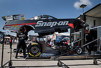 Aug. 30, 2013; Clermont, IN, USA: Crew members for NHRA funny car driver Cruz Pedregon lift the body in the pits during qualifying for the US Nationals at Lucas Oil Raceway. Mandatory Credit: Mark J. Rebilas-