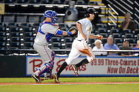 St. Lucie Mets catcher Cam Maron #7 tags out Dan Grovatt #14 in a run down during a game against the Bradenton Marauders on April 12, 2013 at McKechnie Field in Bradenton, Florida.  St. Lucie defeated Bradenton 6-5 in 12 innings.  (Mike Janes/Four Seam Images)