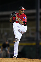Hickory Crawdads relief pitcher Kelvin Vasquez (13) in action against the Charleston RiverDogs at L.P. Frans Stadium on August 25, 2015 in Hickory, North Carolina.  The Crawdads defeated the RiverDogs 7-4.  (Brian Westerholt/Four Seam Images)
