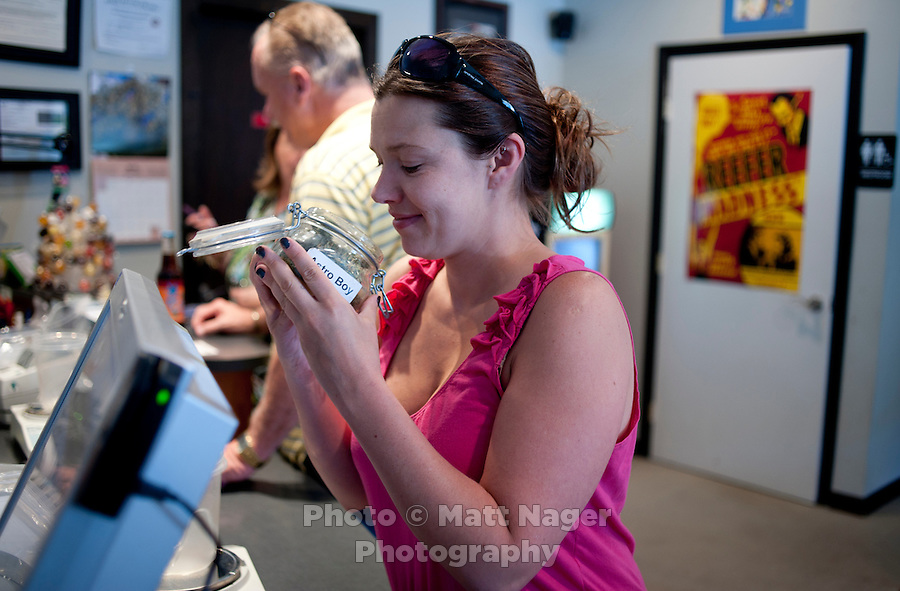 Turia McKenzie (cq) smells a jar of Astro Boy marijuana from the Rocky Mountain Remedies Medical Marijuana Dispensary in Steamboat, Colorado, Wednesday, June 15, 2011. After Colorado voted to allow medical marijuana, Steamboat has seen a large increase in both marijuana stores and medical marijuana card holders...Photo by Matt Nager