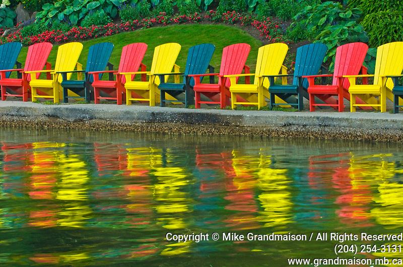 Muskoka chairs reflected in Lake Rosseau<br />Minett<br />Ontario<br />Canada