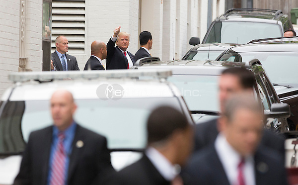 Republican Presidential Candidate Donald Trump, the presumptive Republican Party nominee for President of the United States, gives a thumbs-up as he arrives for a meeting with Speaker of the US House Paul Ryan (Republican of Wisconsin) at the National Republican Congressional Committee Headquarters in Washington, DC, May 12, 2016. <br /> Credit: Chris Kleponis / CNP/MediaPunch